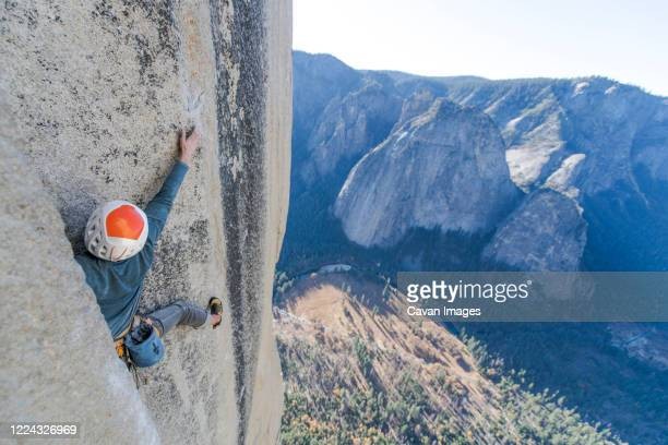rock climber crack climbing on the nose, el capitan in yosemite - chalk bag stock pictures, royalty-free photos & images