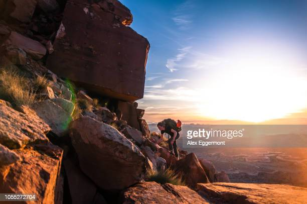 rock climber, desert towers,creek, moab, utah, usa - moab utah stock photos and pictures
