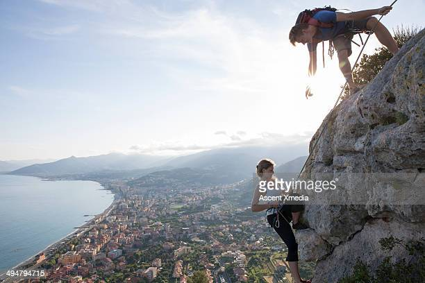 Rock climber instructing partner