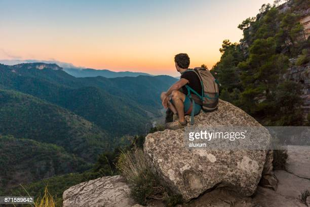 rock climber looking at landscape at sunset in siurana catalonia spain - tarragona stock photos and pictures