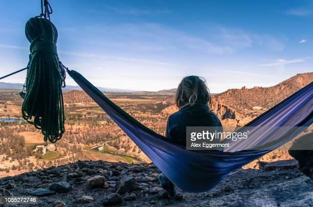 rock climber on hammock on summit, smith rock state park, oregon, usa - smith rock state park stock pictures, royalty-free photos & images