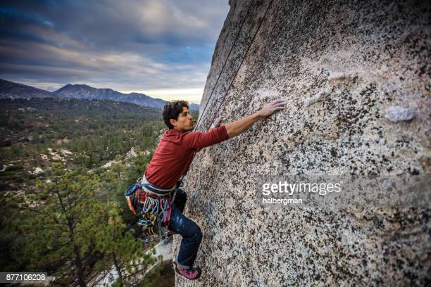 rock climber reaching up - arrampicata su roccia foto e immagini stock