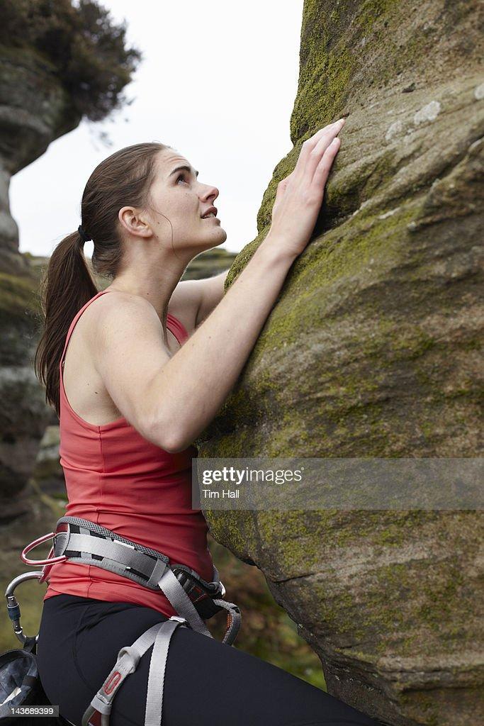 Rock climber scaling boulder : Stock Photo