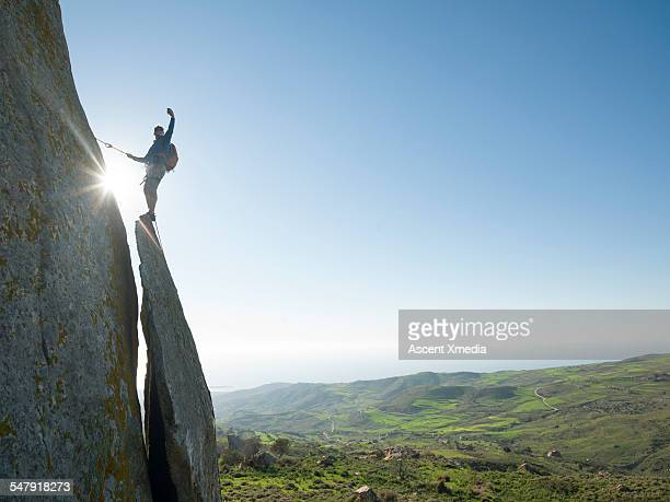 Rock climber takes selfie portrait on ridge crest