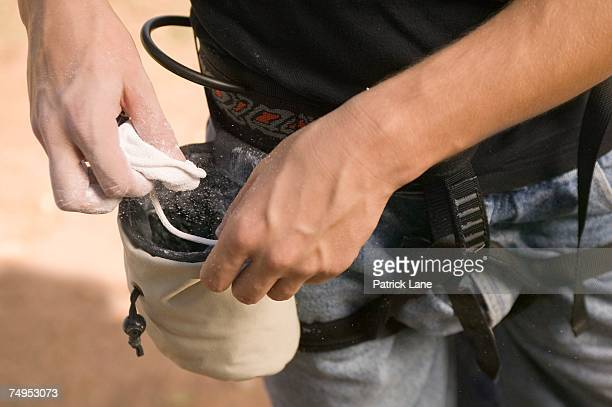 rock climber with chalk bag and chalk - chalk bag stock pictures, royalty-free photos & images