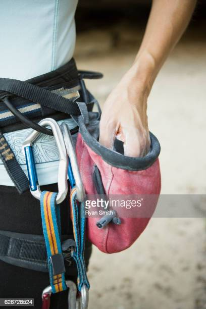rock climber with chalk bag - chalk bag stock pictures, royalty-free photos & images