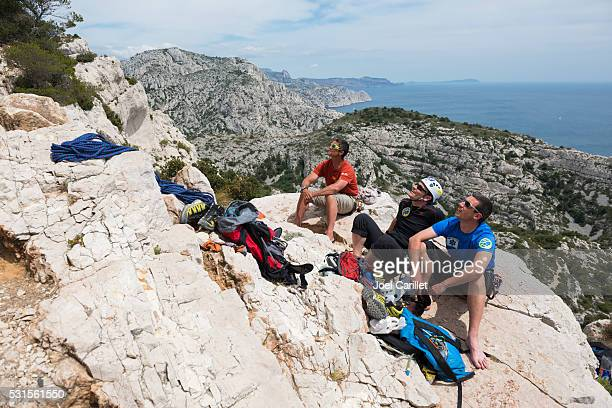 rock climbers in the calanques near marseille, france - calanques stock pictures, royalty-free photos & images