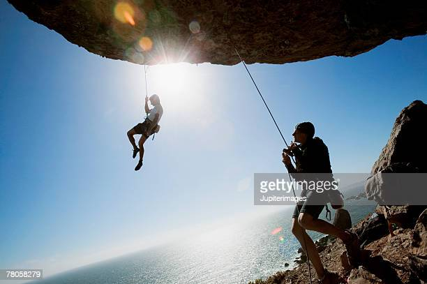 rock climbers - rock overhang stock photos and pictures