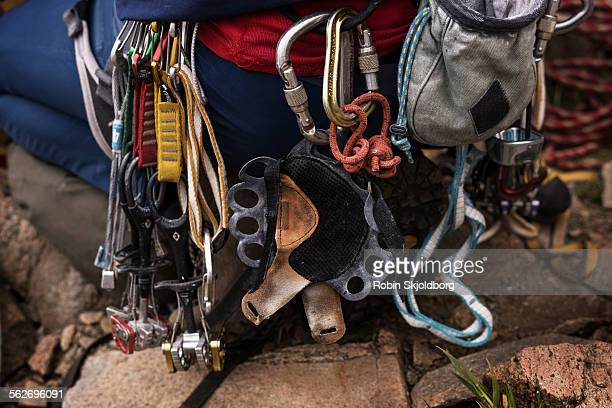 rock climbing equipment hanging on climber - robin skjoldborg stock pictures, royalty-free photos & images