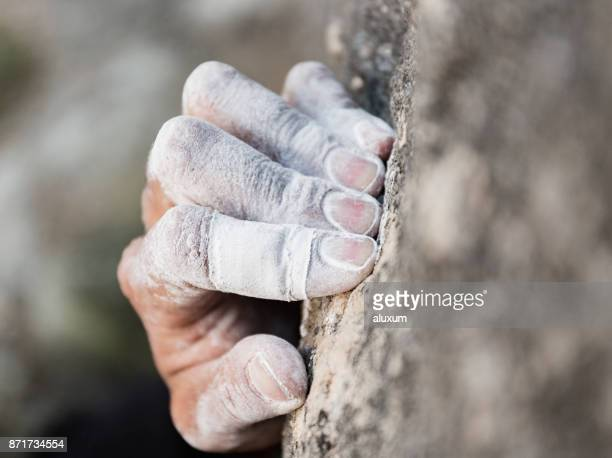 rock climbing hand with chalk - climbing stock pictures, royalty-free photos & images