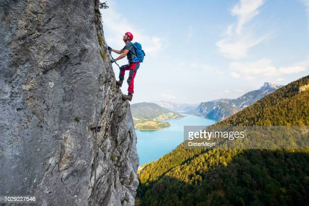 rock climbing in alps - climbing stock pictures, royalty-free photos & images