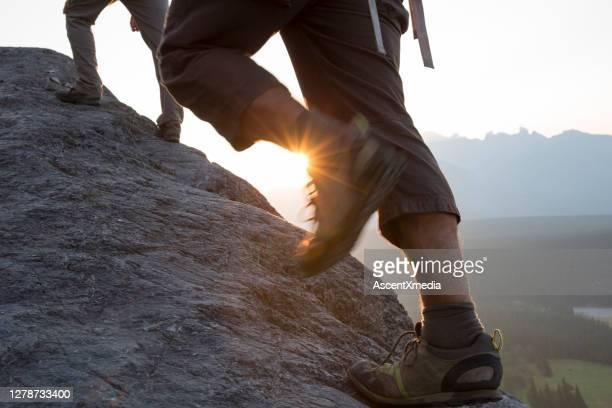 rock climbing mountain rope - human leg stock pictures, royalty-free photos & images