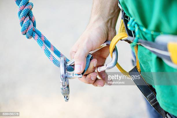rock climbing preparation - safety harness stock photos and pictures