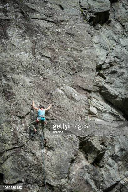 Rock climbing young woman on Italian Alps: Mountain climbing