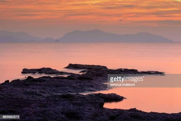 Rock coastline in sun set time