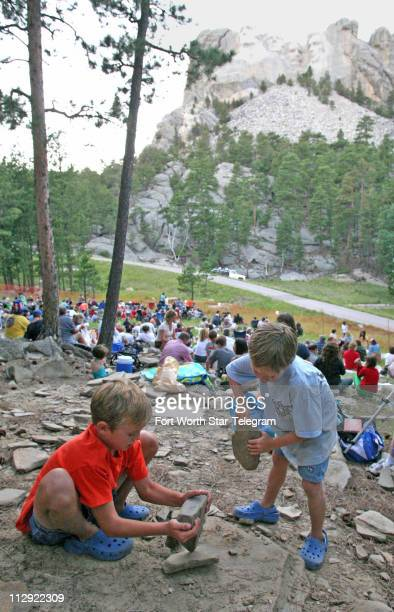 Rock collectors Miles left and Mason Cooper right of Key West Florida smash rocks at the foot of Mount Rushmore National Monument in South Dakota