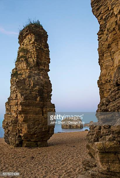 Rock columns at the water's edge along the coast
