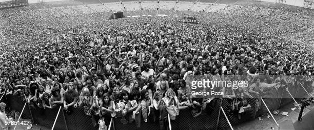 Rock concert fans jam the Los Angeles Memorial Coliseum to view a 1979 summer performance by Foreigner and Eddie Money in Los Angeles, California.