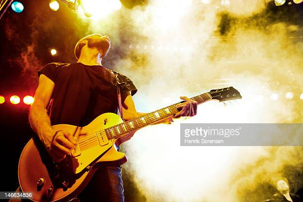 rock concert - electric guitar stock pictures, royalty-free photos & images