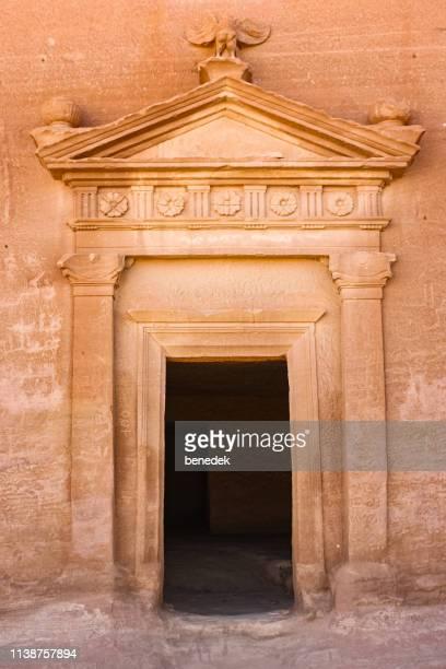 rock cut tomb entrance in mada'in saleh saudi arabia - mada'in saleh stock pictures, royalty-free photos & images