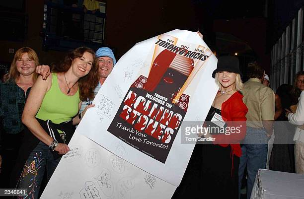 Rock fans hold a banner as they attend a preSARS concert July 29 2003 in Toronto Canada The party was organized by Val Dooly to celebrate the Rolling...