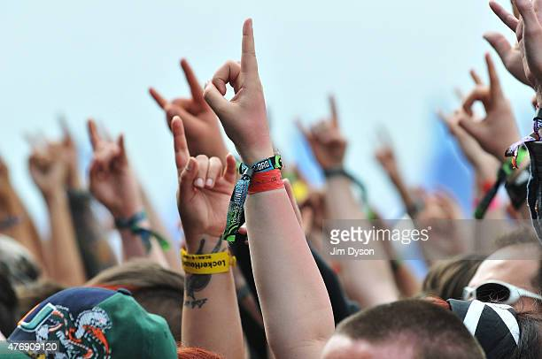 Rock fans watch performers on the mian stage during Day 1 of the Download Festival at Donington Park on June 12 2015 in Castle Donington England