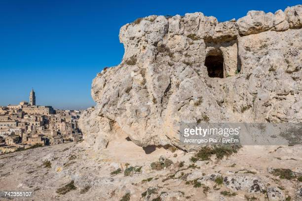 Rock Formation Against Clear Blue Sky At Sassi Di Matera