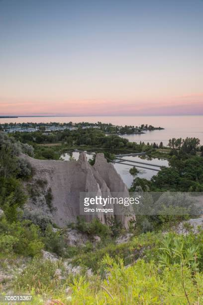 rock formation and sea at sunset - image stock pictures, royalty-free photos & images