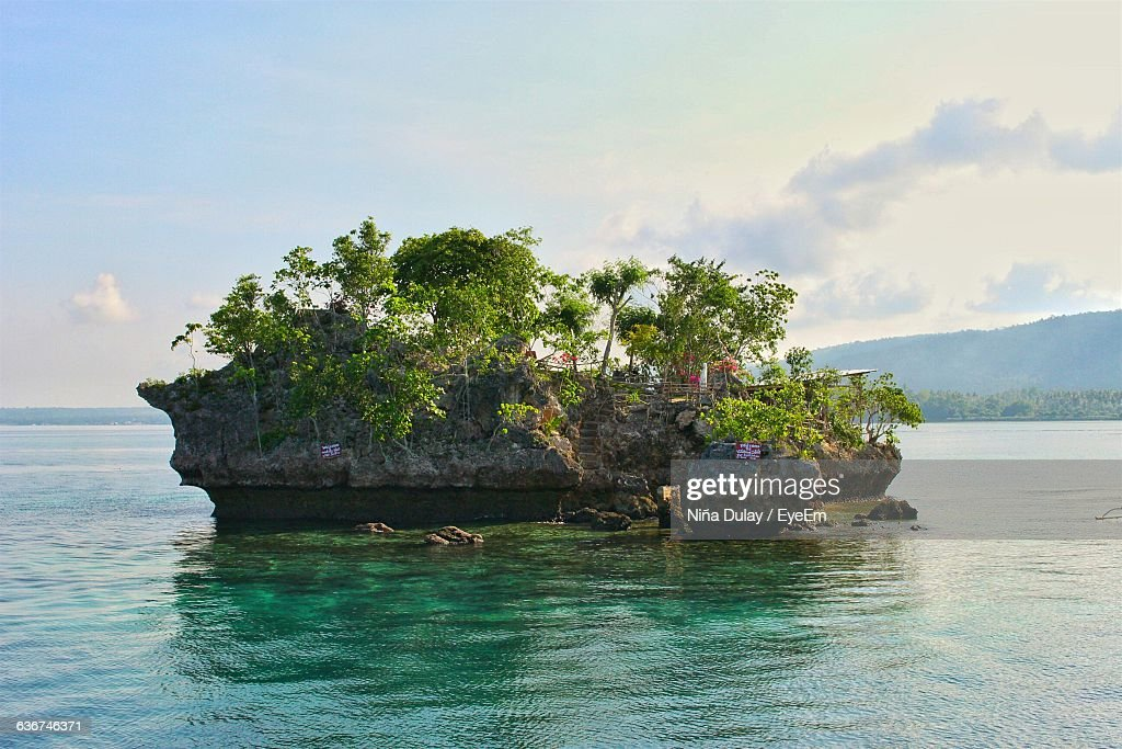 Rock Formation At Wishing Island Against Sky : Stock Photo