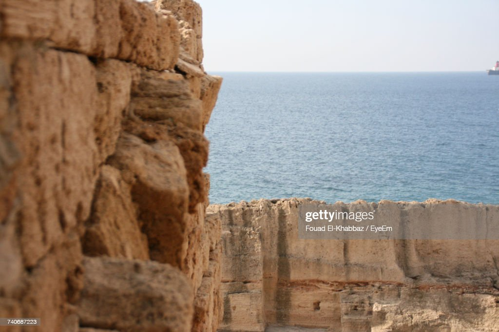 Rock Formation By Sea Against Clear Sky : Stock Photo