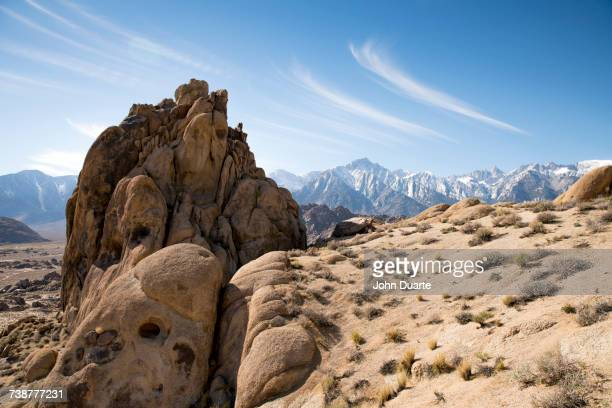 rock formation in desert landscape - alabama hills stock photos and pictures