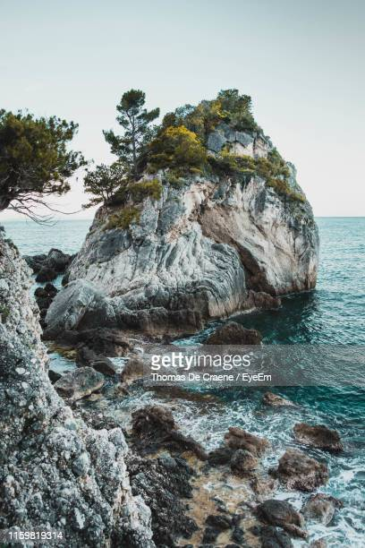 rock formation in sea against clear sky - stack rock stock pictures, royalty-free photos & images