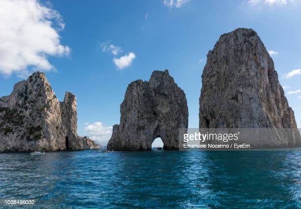 rock formation in sea against sky - stack rock stock pictures, royalty-free photos & images