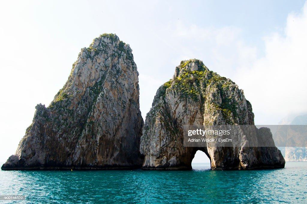 Rock Formation In Sea Against Sky : Stock Photo
