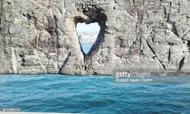 rock formation in sea against sky - la jolla stock pictures, royalty-free photos & images