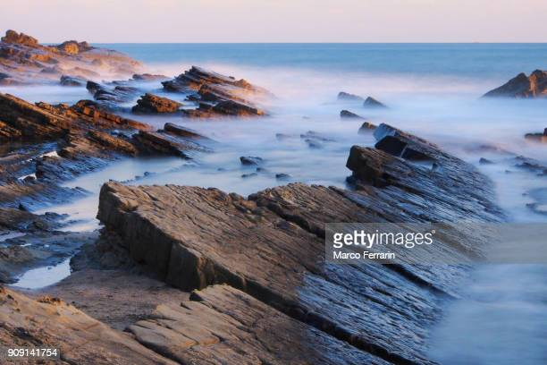 rock formation in sea at winter sunset, chiba, japan - physical geography stock pictures, royalty-free photos & images
