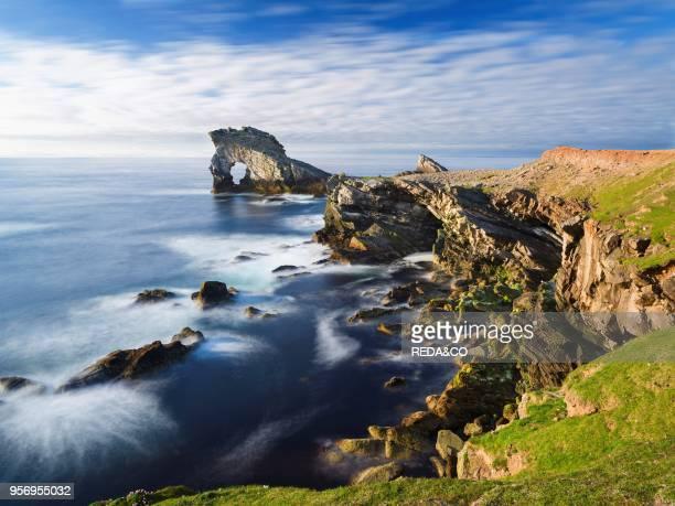 Rock formation known as Gada's Stack on Foula Island Shetlands Scotland United Kingdom Europe