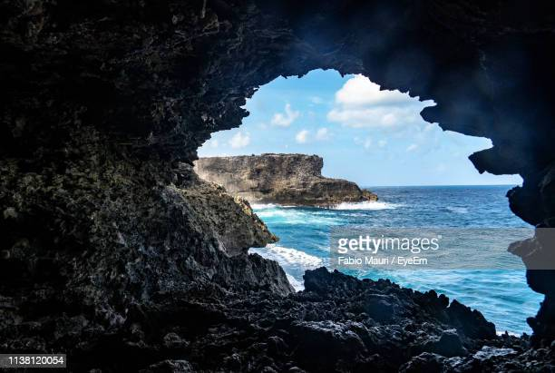 rock formation on beach against sky - bridgetown barbados stock photos and pictures