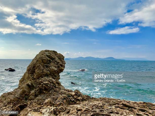 rock formation on beach against sky - file:the_wyoming,_orlando,_fl.jpg stock pictures, royalty-free photos & images