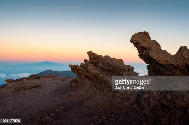 rock formation on land against sky during sunset - josh utley stock pictures, royalty-free photos & images