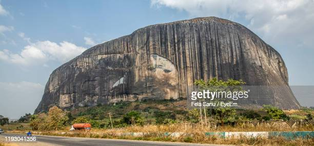 rock formation on land against sky - abuja stock pictures, royalty-free photos & images