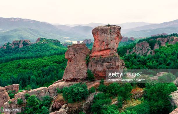 rock formation on mountain against sky - krasimir georgiev stock photos and pictures
