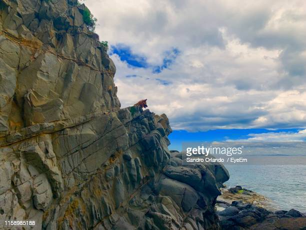 rock formation on sea against sky - special:whatlinkshere/file:lucerne_circle,_orlando,_fl.jpg stock pictures, royalty-free photos & images