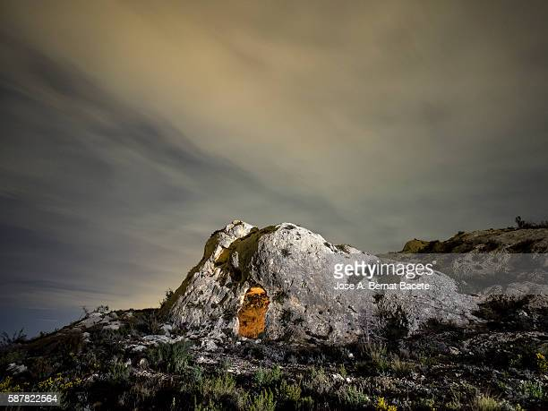 rock formation with a cave excavated by the man as refuge in the night - pinnacle peak stock pictures, royalty-free photos & images