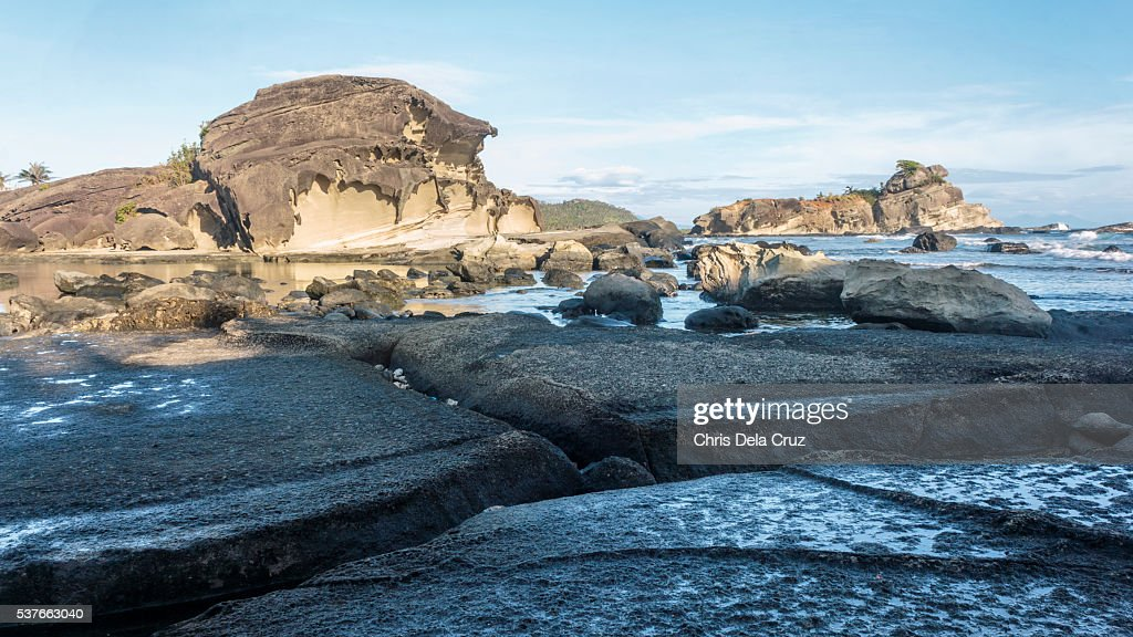 Rock formation with big crack on ground on the foreground : Stock Photo