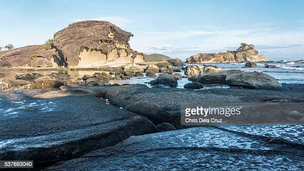 rock formation with big crack on ground on the foreground - crack imagens e fotografias de stock