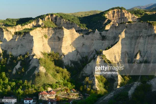 rock formations above melnik town - pyramid shapes around the house stock pictures, royalty-free photos & images