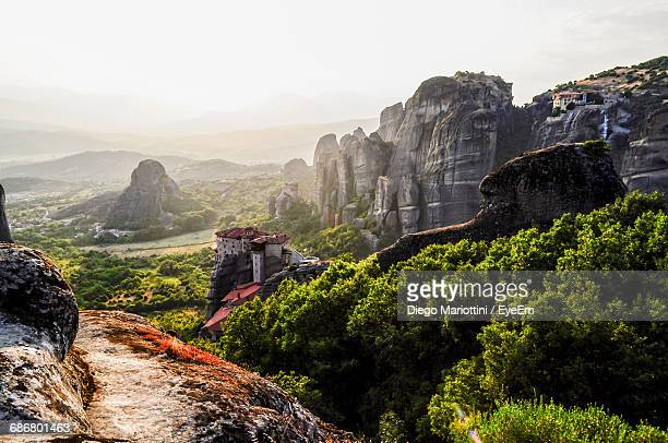 rock formations against sky - meteora stock pictures, royalty-free photos & images