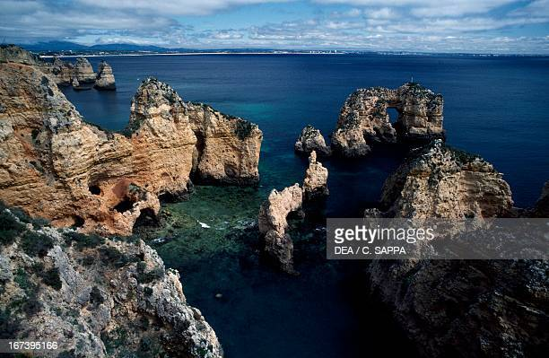 Rock formations along the promontory of Ponta da Piedade near Lagos Faro district Algarve Portugal