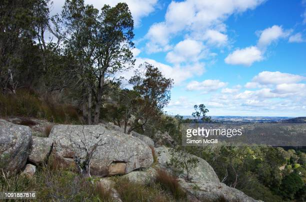 rock formations and bush land in mount gibraltar heritage reserve, mittagong, new south wales, australia - valley stock pictures, royalty-free photos & images